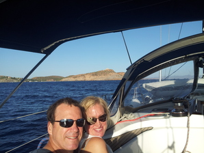 Happy couple sailing in Greece